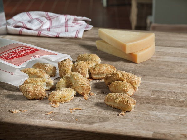 Parmesan Bread Bites spread on a cutting board