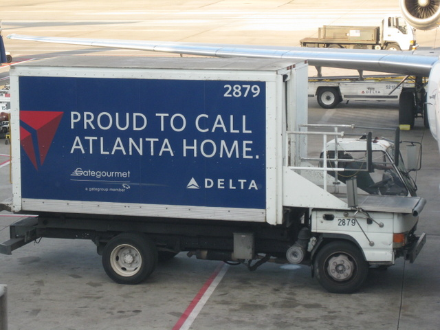 "Delta truck with a sign that says ""Proud to call Atlanta home"""