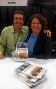 Barry Moltz and Becky McCray signing Small Town Rules at BlogWorld Expo