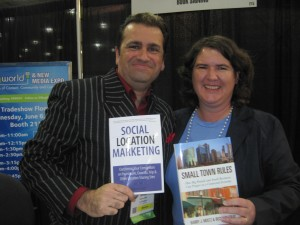 Simon Salt and Becky McCray show off their books at BlogWorld. Photo by Shashi Bellamkonda