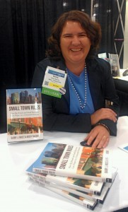 Becky McCray signing Small Town Rules at BlogWorld