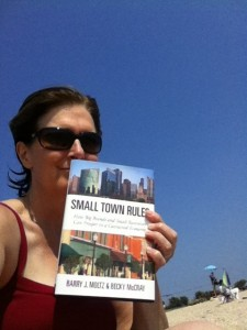 Joyce M Sullivan on the beach with Small Town Rules