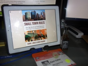 In Puerto Rico, Raul J. Colon has Small Town Rules on his desktop, along with Becky's liquor business card