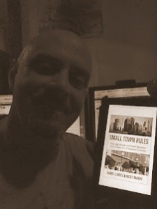 Rob Hatch with Small Town Rules on his Kindle