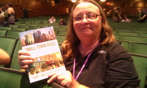 In New York City, Sally Bair went out and bought a copy of Small Town Rules during 140conf