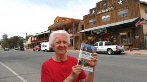 Sheila Scarborough's mom shows off her copy of Small Town Rules in Fort Davis, Texas