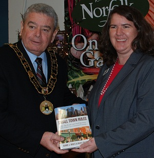 Mayor of Norfolk County Ontario Dennis Travale and Becky McCray with his copy of Small Town Rules