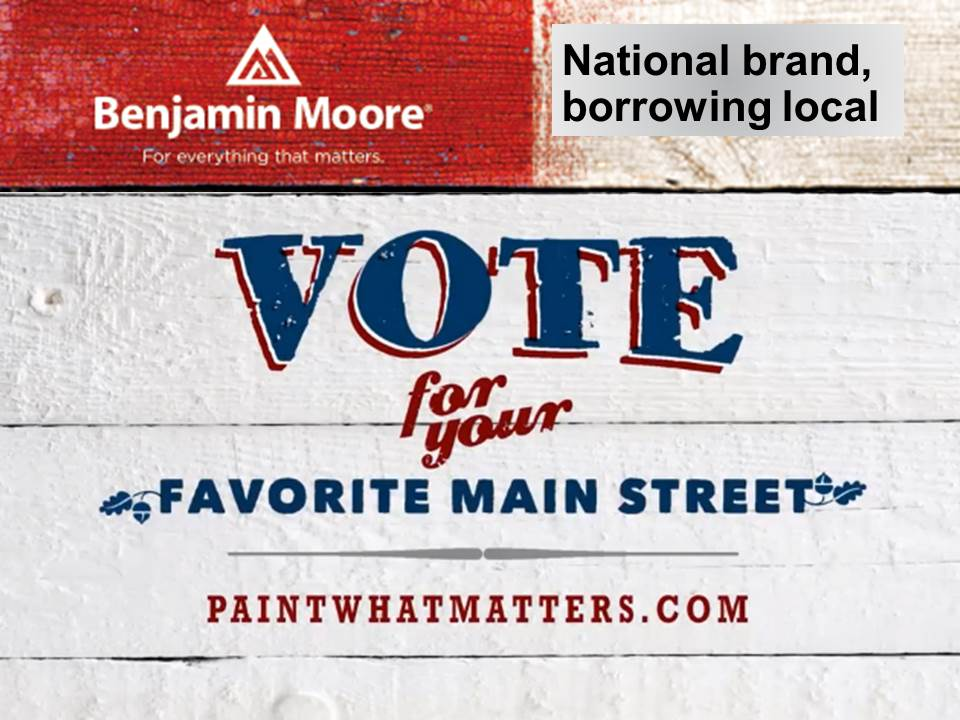 "Rustic painted sign says, ""Vote for your favorite Main Street."""